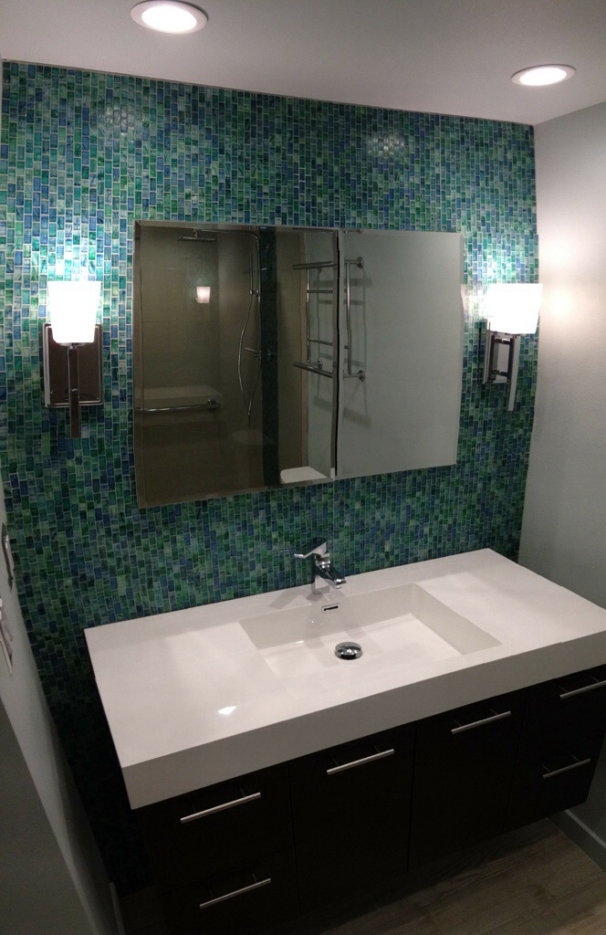 Glass Mosaic Tiles Create A Bath Vanity Feature Wall By